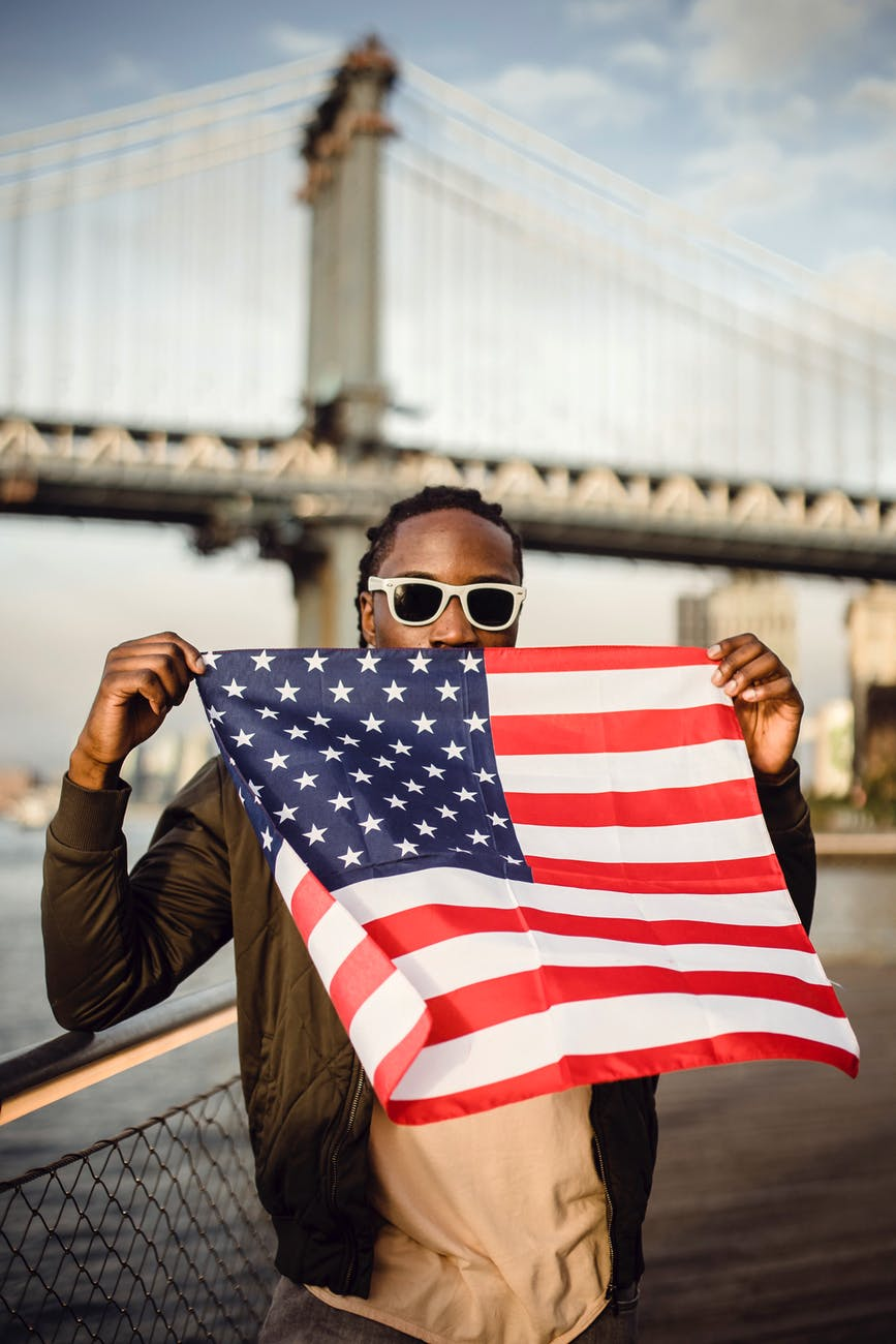 young african american male with american flag bandana on waterfront